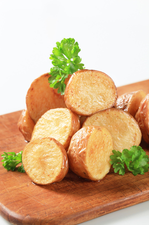halved  half: Oven-roasted new potatoes on a cutting board
