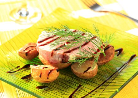 balsamic: Pork loin steak and baked potatoes poured with balsamic reduction Stock Photo