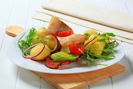 alaska pollock: Fish skewer and potatoes with leek and arugula