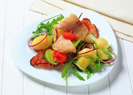 alaska pollock: Fish skewer and potatoes with leek and arugula