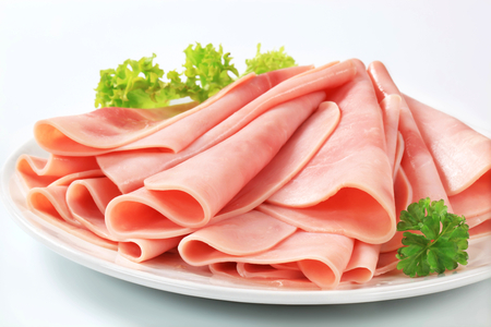 thinly: Thinly sliced ham on a plate