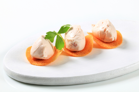 crisps: Ham or salmon mousse on spicy crisps