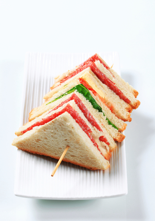 multilayered: Multi-layered sandwich with thin sliced salami Stock Photo