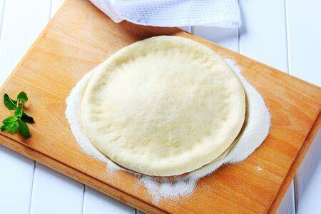yeast: Yeast dough on a cutting board Stock Photo