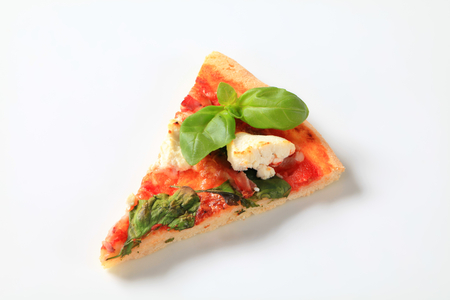 Piece of pizza with cheese, bacon and spinach