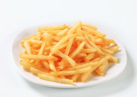 french fries plate: Fresh fried French fries on plate Stock Photo