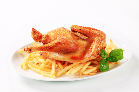 Crispy skin roast chicken with French fries
