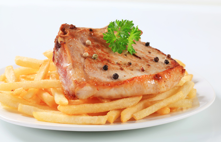 seared: Pan seared pork chop with French friesfries