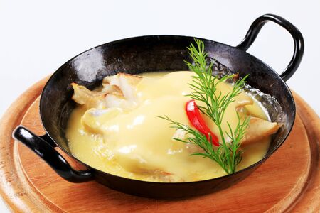 seared: Pan-seared white fish with rich  sauce Stock Photo