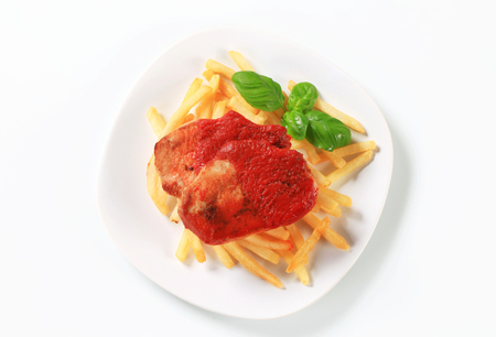 pork chop: Pan seared pork chop with tomato sauce and French fries