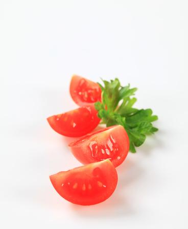quarters: Studio shot of fresh tomato quarters Stock Photo
