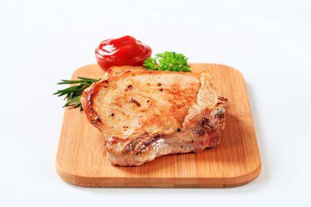 chops: Studio shot of pan-fried pork chops Stock Photo