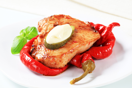 pork chop: Spicy glazed pork chop with pickled peppers Stock Photo