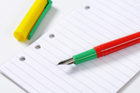 lined paper: fountain pen without cap on white lined paper Stock Photo