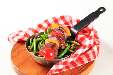 Liver skewer with green beans and sweetcorn photo