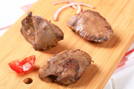 pan fried: Pan fried liver on cutting board