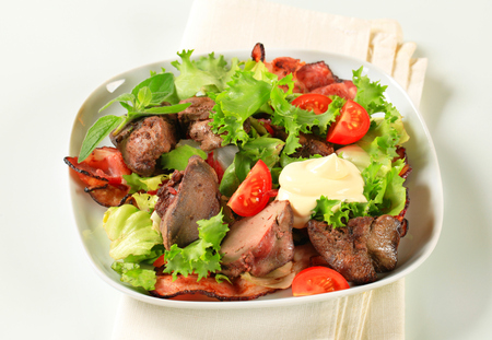 the greens: Pan fried chicken livers with salad greens and bacon strips
