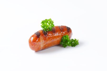 grilled sausage on white background photo