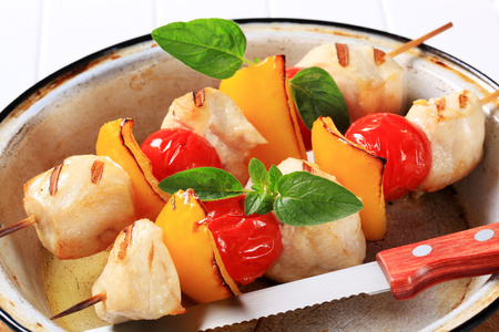 chunks: Grilled chicken chunks with cherry tomatoes and yellow pepper on skewers