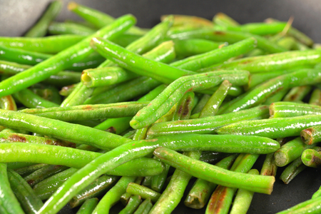 accompaniment: Green beans on a frying pan Stock Photo