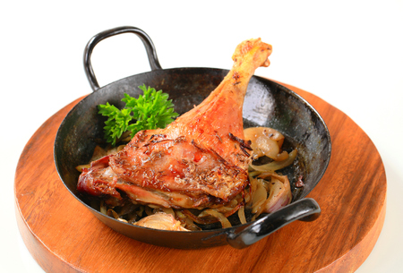 skillet: Roast duck leg and onion in a skillet