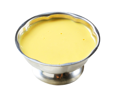 serving dish: Vanilla custard in a metal serving dish
