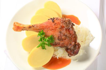 Roast duck leg with potato dumplings and sauerkraut photo