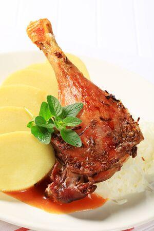 high calorie foods: Roast duck leg with potato dumplings and sauerkraut Stock Photo