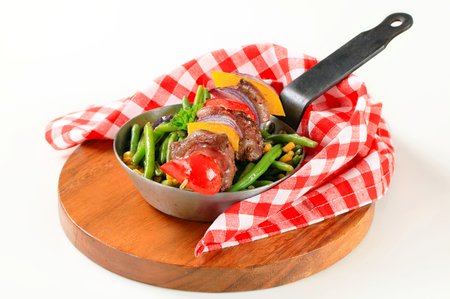 sweetcorn: Liver skewer with green beans and sweetcorn Stock Photo