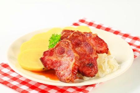 high calorie foods: Roast pork with potato dumplings and sauerkraut Stock Photo