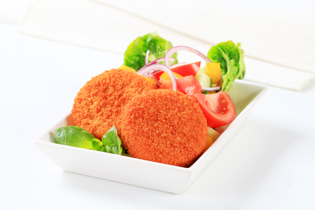 fresh food fish cake: Fried cheese with fresh vegetable salad