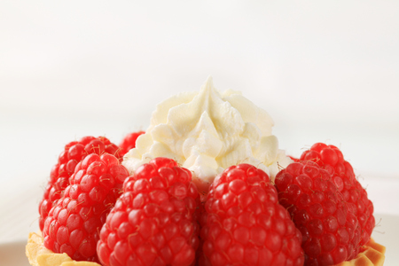 short crust pastry: Pastry crust filled with fresh raspberries and cream