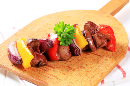 spanish onion: Chicken liver and vegetables on skewer Stock Photo