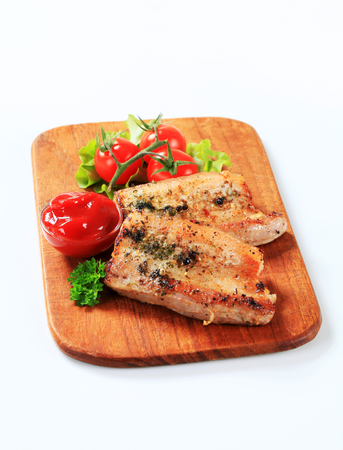 belly pepper: Pork meat rubbed with spices and herbs and bowl of tomato sauce Stock Photo