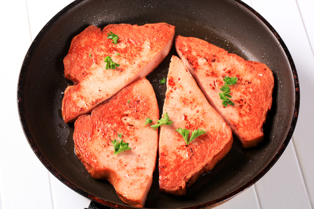 frying pan: Pan fried lunchmeat on a frying pan Stock Photo