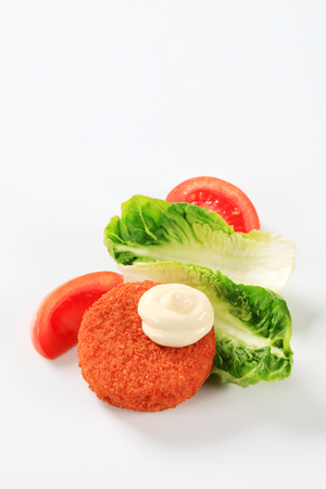 breaded: Fried breaded cheese with mayonnaise Stock Photo