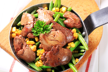 sweetcorn: Pan-fried chicken livers with green beans and sweetcorn