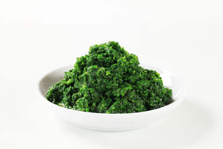 chopped: Chopped spinach on a plate Stock Photo