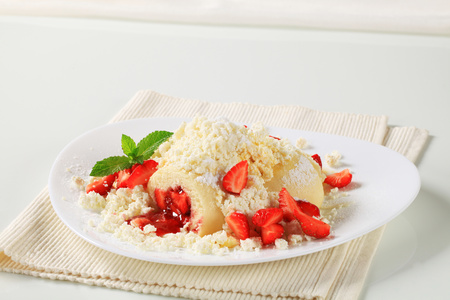 Strawberry dumplings with cottage cheese, sugar and butter photo