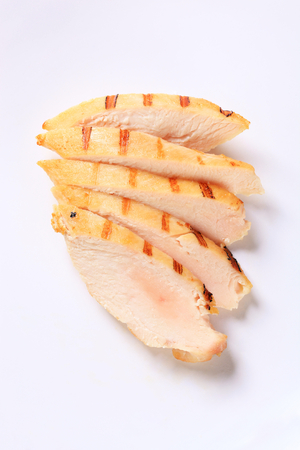 Slices of grilled chicken breast fillet 스톡 콘텐츠