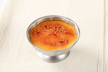 serving dish: Creme brulee in a metal serving dish