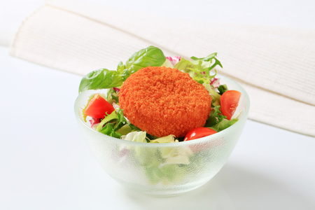 breaded: Fried breaded cheese with green salad