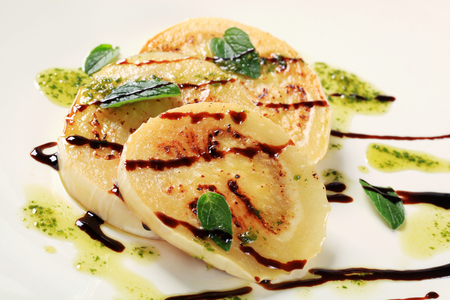 balsamic vinegar: Slices of pan fried aubergine with pesto and balsamic vinegar