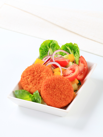 fresh food fish cake: Fried cheese or fish cakes with fresh vegetable salad
