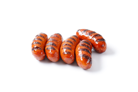 grilled sausages on white background photo