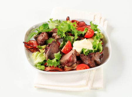 salad greens: Pan fried chicken livers with salad greens and bacon strips