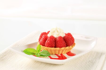 crust: Pastry crust filled with fresh raspberries and cream