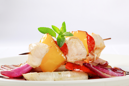 balsamic vinegar: Chicken skewer with pan roasted vegetables and balsamic vinegar Stock Photo