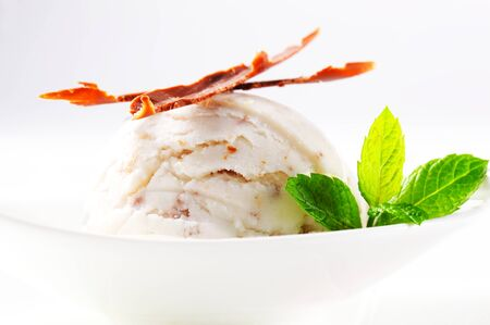 stracciatella: Scoop of stracciatella ice cream topped with chocolate shavings Stock Photo