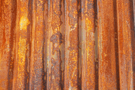 corrugation: Old corrugated metal sheet covered with rust